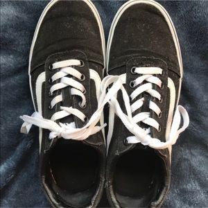 Pair of black vans low top sneakers